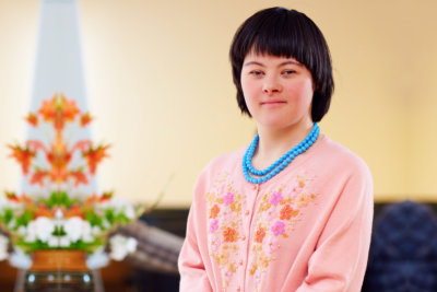 Portrait of young adult woman with down`s syndrome at rehabilitation center