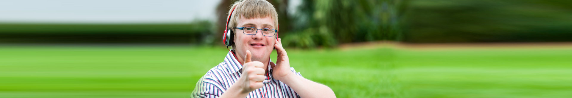 Close up portrait of down syndrome boy with headset