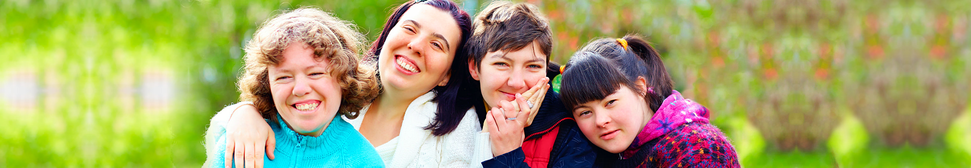 four woman with disability smiling